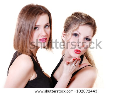 Two fashionable look beautiful girls send air kiss
