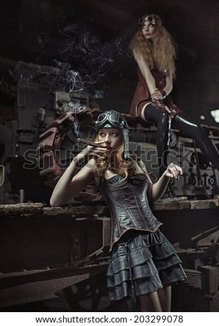 Two fashionable women in an old factory - stock photo