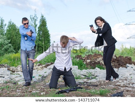 Two FBI agents conduct arrest of an offender - stock photo