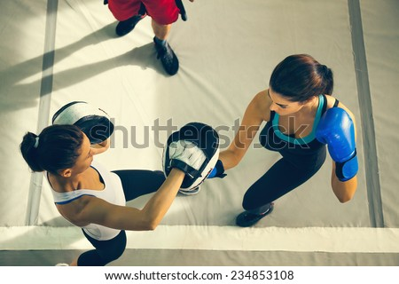 Two Female Boxers Sparring - stock photo
