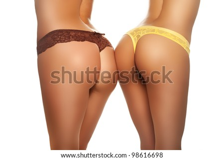 Two female buttocks in sexy brown and yellow underwear - stock photo