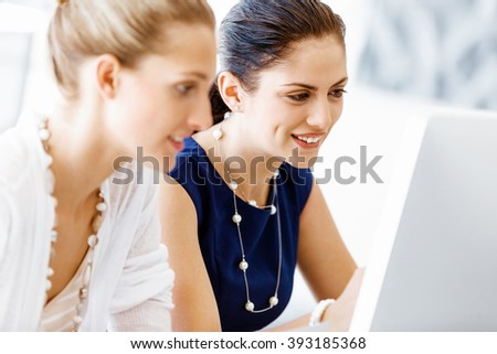 Two female colleagues in office