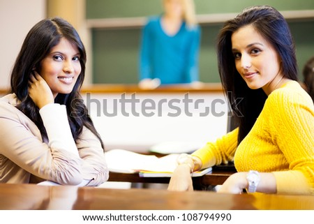 two female college students in classroom - stock photo