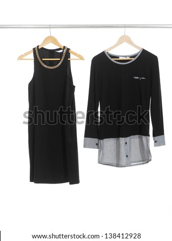 Two female dress isolated on hanging - stock photo
