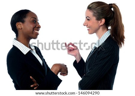 Two female employees talking casually