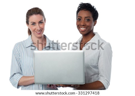 Two female employees working together - stock photo