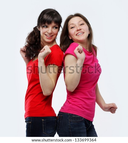 Two female friends dancing  and singing - stock photo