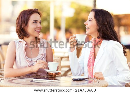 Two female friends enjoying morning coffee.