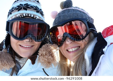 Two female friends in ski clothing - stock photo