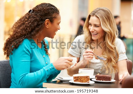 Two Female Friends Meeting In Cafe