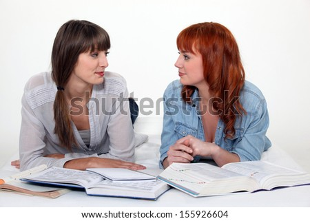 Two female friends studying.