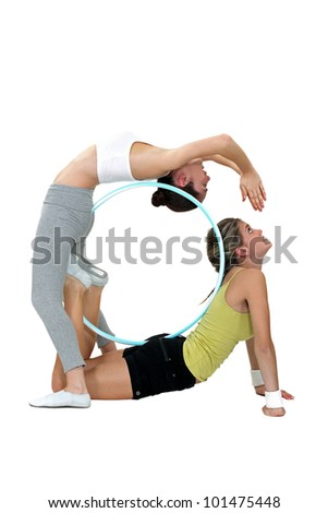 Two female gymnasts - stock photo