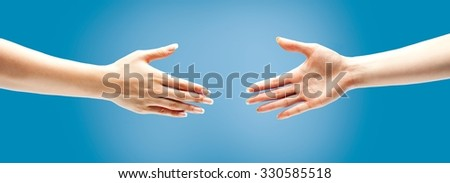 Two female hands about to handshake.