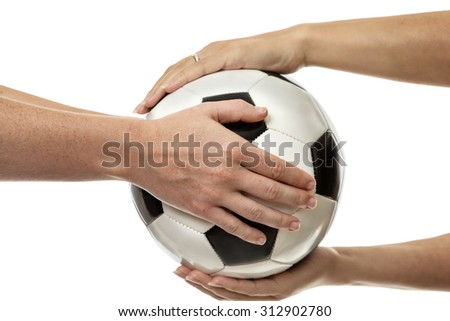 two female hands passing a ball to each other