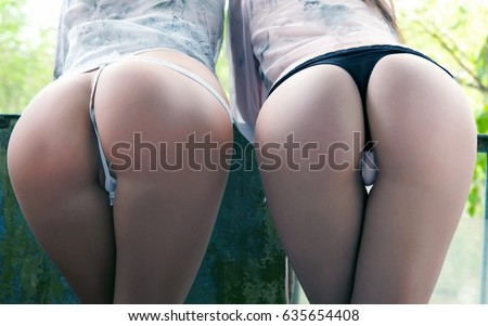 two girls with big butts