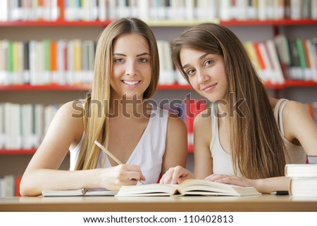 Two female students at the library