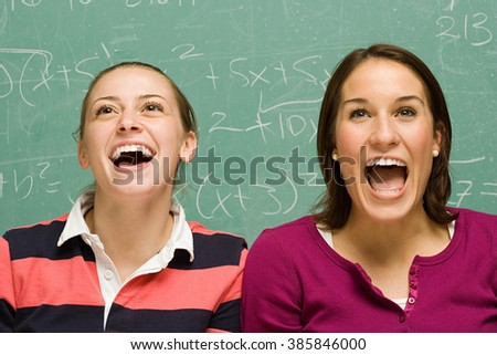 Two female students showing surprise - stock photo
