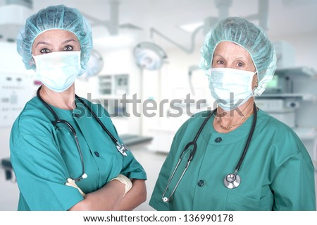 two female surgeons in the operating room - stock photo