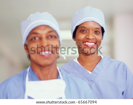 Two female surgeons smiling - stock photo