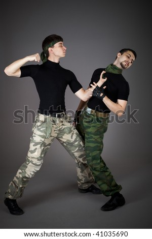 Two fighting man on gray background - stock photo