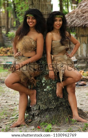Two filipino girls leaning on tree stock photo edit now 1100962769 two filipino girls leaning on tree wearing native clothing thecheapjerseys Choice Image