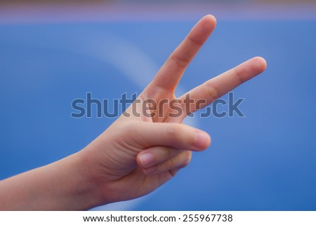 Two finger sign as hand gesture - stock photo