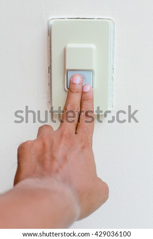 Two finger touch buzzer on the wall