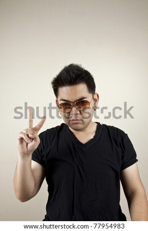 Two fingers, A man wearing sunglasses sign two finger.