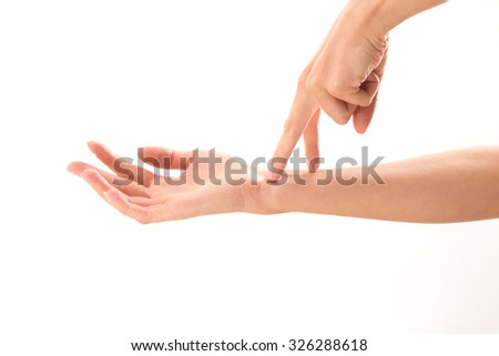 Two fingers coming on woman's hand demonstrating different life situations over white background. It is nice idea to show relations betweent family members.