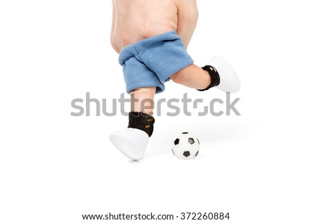 Two fingers in sportswear kick the ball isolated on white background - stock photo