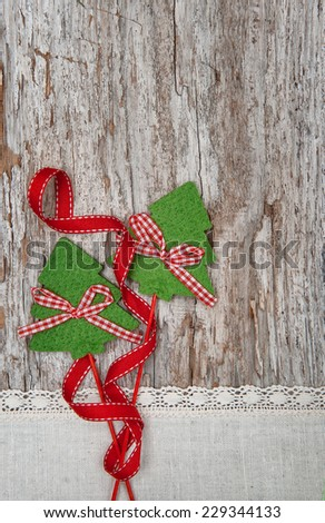 Two fir tree on the old wood background