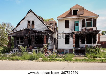 Two fire damaged houses in Detroit, Michigan - stock photo