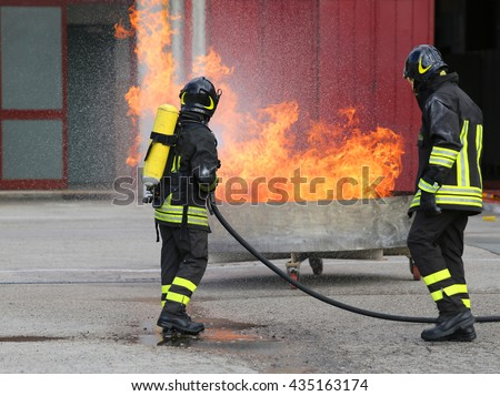 two firefighters with oxygen bottles off the fire during a training exercise in Firehouse