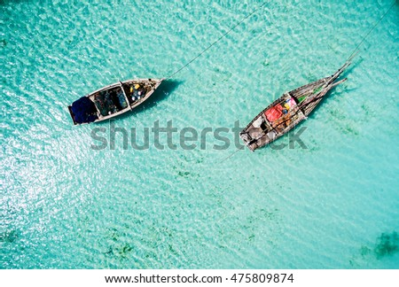 two fishing boats among clear ocean water near Africa, top view