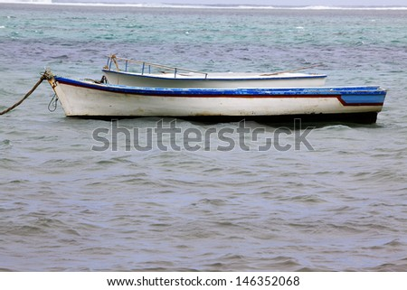 Two fishing boats on remote beach
