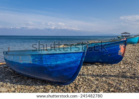 Two Fishing Row Boats on Shore