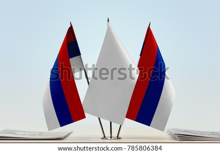Two flags of Republika Srpska with a white flag in the middle