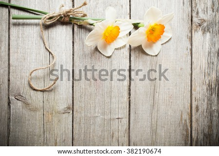 two flowers on wooden background - stock photo