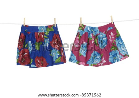 Two flowers skirt on a clothespins on rope
