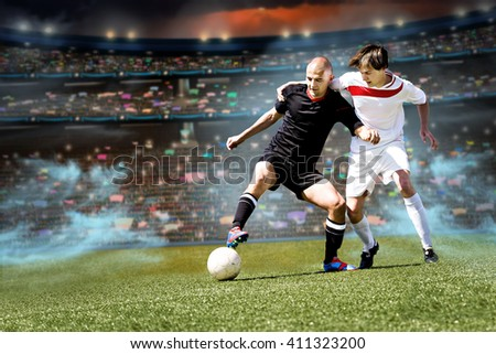 two football or soccer players from opposing team on the field