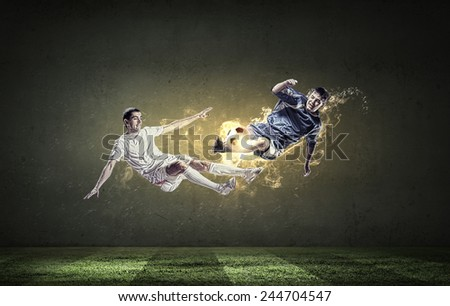 Two football players in jump fighting for ball