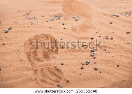 two footprints from human astronaut on martian surface - stock photo