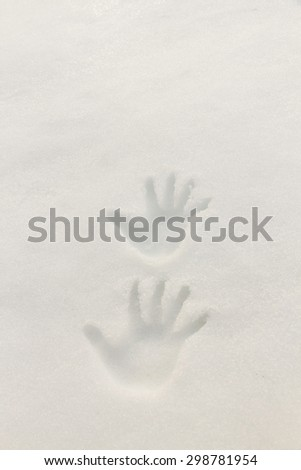 Two footprints in the snow hands recorded