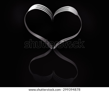 Two forks forming a heart on a black background and a reflective floor - stock photo