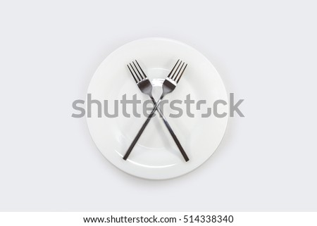 two forks lie on a plate
