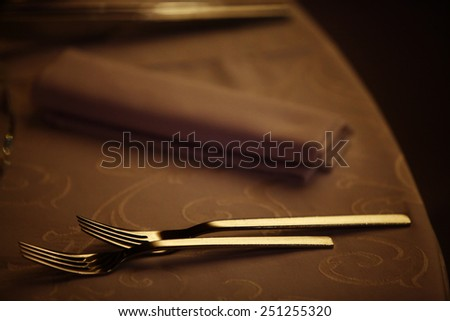 Two forks on a dinner table in a restaurant. - stock photo