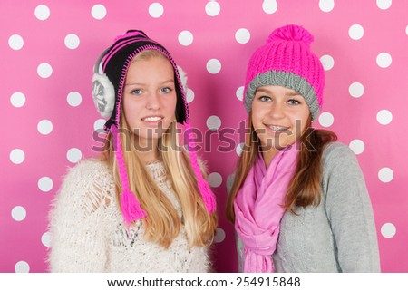 Two fourteen years old teens as girlfriends in winter - stock photo