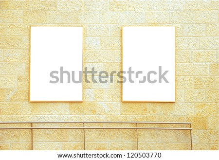 Two frames on a brick wall with a copy space area. - stock photo