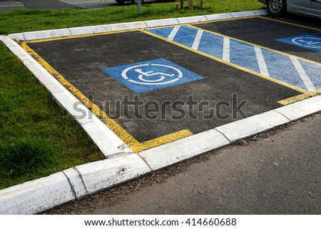 Two free parking for disabled people - stock photo