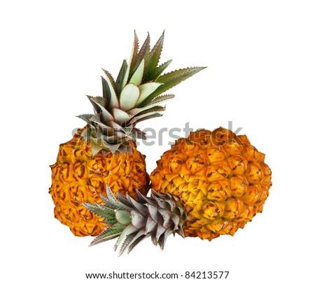 Two fresh bright orange pineapples isolated on white background - stock photo
